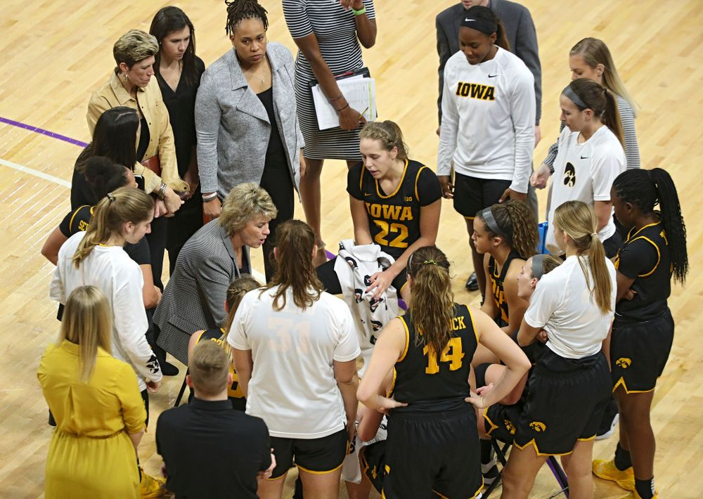 Iowa Hawkeyes head coach Lisa Bluder talks with her team during a timeout in the fourth quarter of their game at Welsh-Ryan Arena in Evanston, Ill. on Sunday, January 5, 2020. (Stephen Mally/hawkeyesports.com)