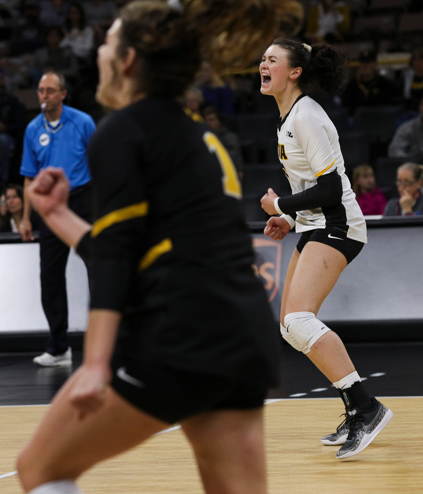 Iowa Hawkeyes defensive specialist Halle Johnston (4) celebrates after winning a point during a match against Rutgers at Carver-Hawkeye Arena on November 2, 2018. (Tork Mason/hawkeyesports.com)
