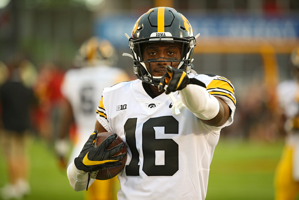 Iowa Hawkeyes wide receiver Charlie Jones (16) warms up with his teammates before their Iowa Corn Cy-Hawk Series game at Jack Trice Stadium in Ames on Saturday, Sep 14, 2019. (Stephen Mally/hawkeyesports.com)