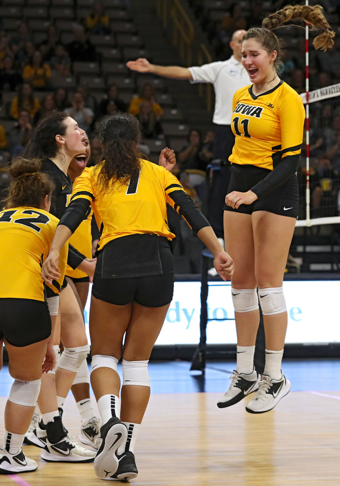 Iowa's Blythe Rients (11) celebrates a block with Emily Bushman (12), Halle Johnston (4), Griere Hughes (10), and Brie Orr (7) during their match at Carver-Hawkeye Arena in Iowa City on Sunday, Oct 20, 2019. (Stephen Mally/hawkeyesports.com)