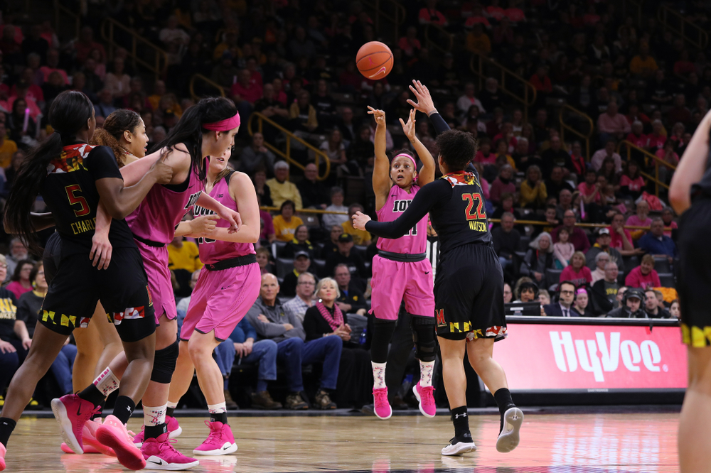 Iowa Hawkeyes guard Tania Davis (11) drains a three point basket against the seventh ranked Maryland Terrapins Sunday, February 17, 2019 at Carver-Hawkeye Arena. (Brian Ray/hawkeyesports.com)