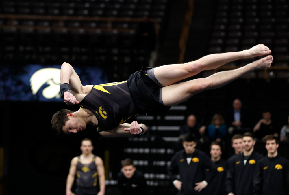 Mark Springett competes on the floor against Minnesota and Air Force