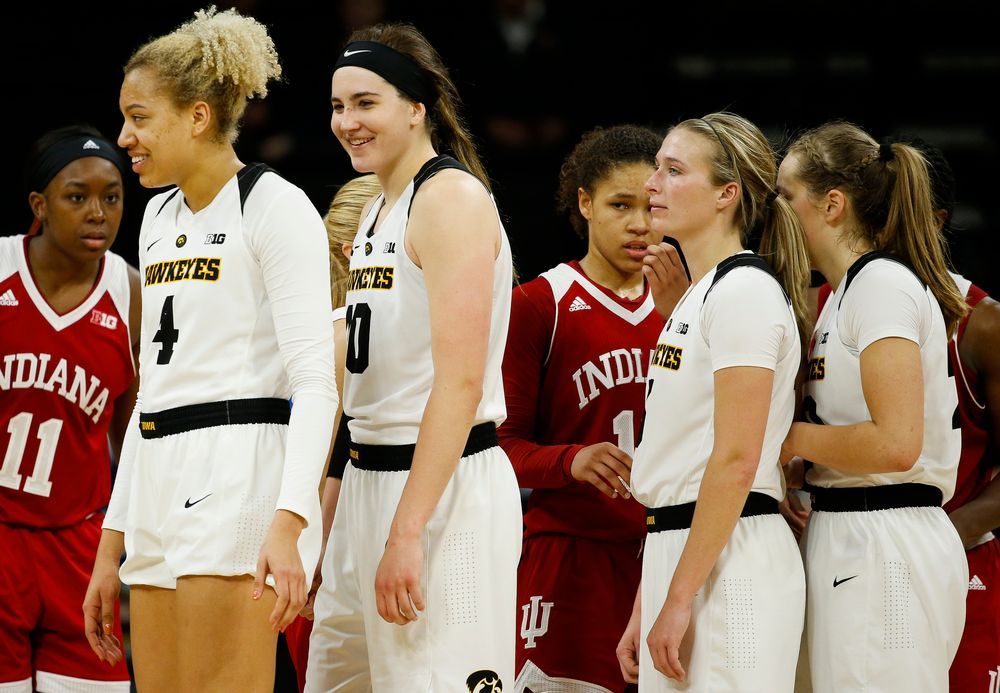 Iowa Hawkeyes forward Chase Coley (4), Iowa Hawkeyes forward Megan Gustafson (10), Iowa Hawkeyes guard Makenzie Meyer (3)