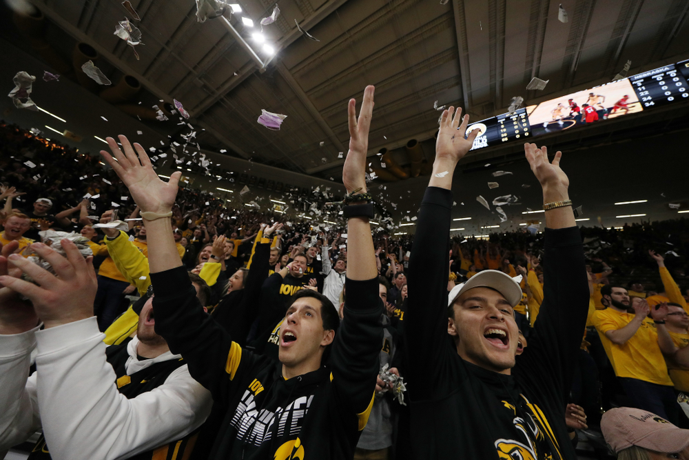 The Hawks Nest throws paper in the air after the Iowa Hawkeyes first basket against the Nebraska Cornhuskers Saturday, February 8, 2020 at Carver-Hawkeye Arena. (Brian Ray/hawkeyesports.com)