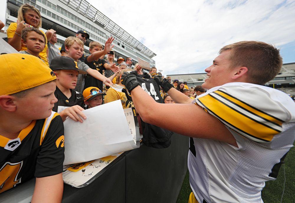 Iowa Hawkeyes linebacker Seth Benson (44) hands back an autographed #44 jersey during Kids Day at Kinnick Stadium in Iowa City on Saturday, Aug 10, 2019. (Stephen Mally/hawkeyesports.com)