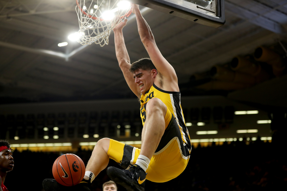 Iowa Hawkeyes forward Luka Garza (55) dunks the ball against the Nebraska Cornhuskers Saturday, February 8, 2020 at Carver-Hawkeye Arena. (Brian Ray/hawkeyesports.com)