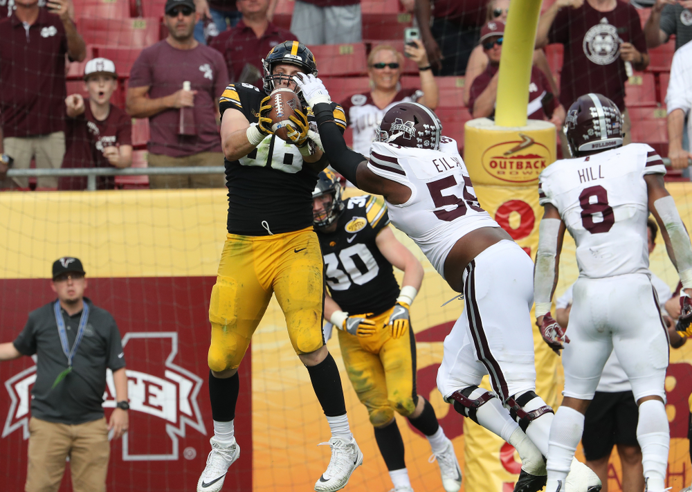 Iowa Hawkeyes defensive end Matt Nelson (96) breaks up an attempted two point conversion during the Outback Bowl Tuesday, January 1, 2019 at Raymond James Stadium in Tampa, FL. (Brian Ray/hawkeyesports.com)