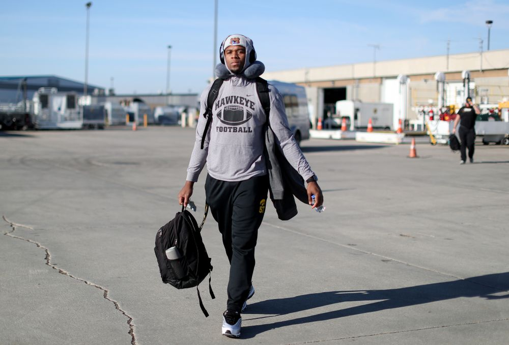 Iowa Hawkeyes defensive end Chauncey Golston (57) boards the team plane at the Eastern Iowa Airport Saturday, December 21, 2019 on the way to San Diego, CA for the Holiday Bowl. (Brian Ray/hawkeyesports.com)