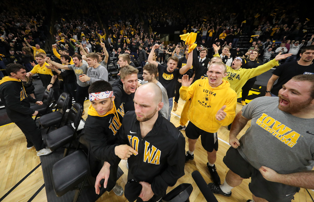 The Iowa bench celebrates during the closing seconds of Tony Cassioppi's 7-0 win over Penn State's Seth Nevills in their dual at Carver-Hawkeye Arena in Iowa City on Friday, January 31, 2020. (Stephen Mally/hawkeyesports.com)
