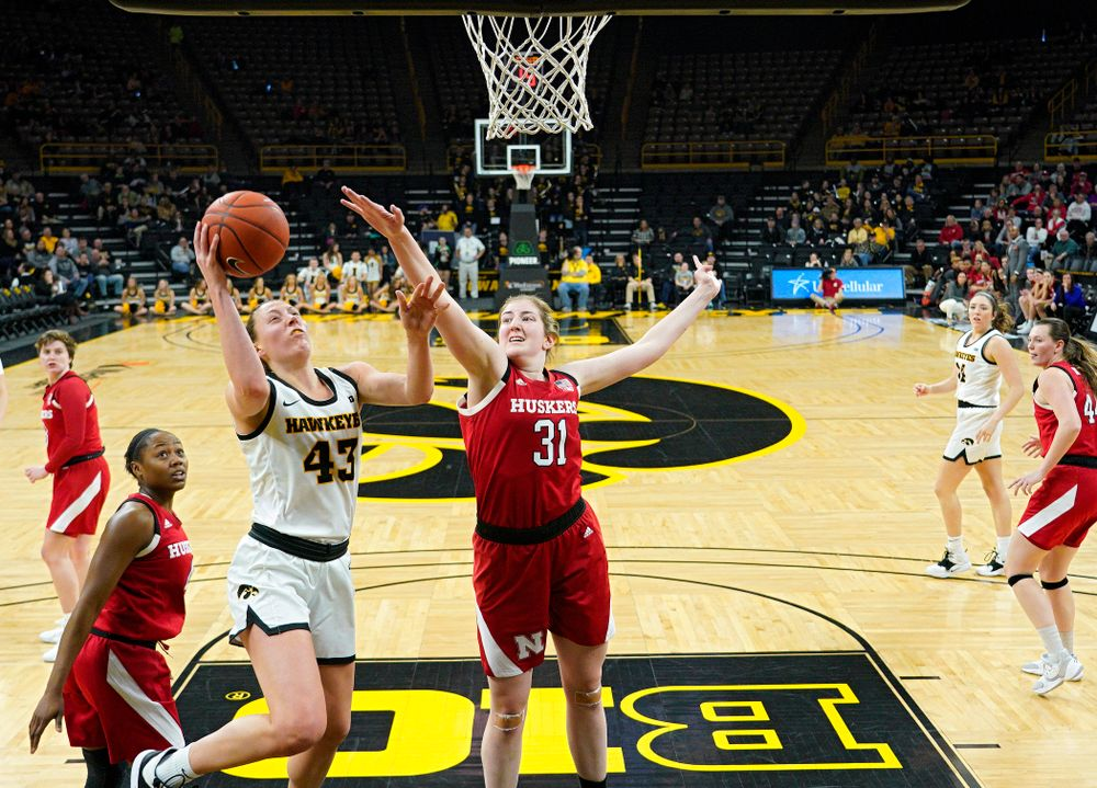 Iowa Hawkeyes forward Amanda Ollinger (43) makes a basket during the fourth quarter of the game at Carver-Hawkeye Arena in Iowa City on Thursday, February 6, 2020. (Stephen Mally/hawkeyesports.com)