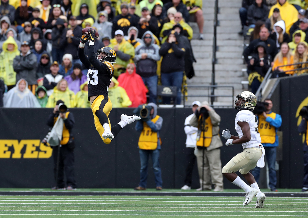 Iowa Hawkeyes defensive back Riley Moss (33) intercepts a pass against the Purdue Boilermakers Saturday, October 19, 2019 at Kinnick Stadium. (Brian Ray/hawkeyesports.com)