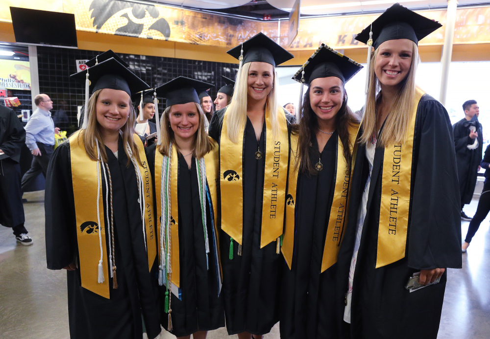Members of the Iowa Rowing Team during the College of Liberal Arts and Sciences spring commencement Saturday, May 11, 2019 at Carver-Hawkeye Arena. (Brian Ray/hawkeyesports.com)