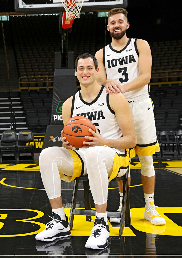 Iowa Hawkeyes forward Ryan Kriener (15) and guard Jordan Bohannon (3) pose for a photo during Iowa Men's Basketball Media Day at Carver-Hawkeye Arena in Iowa City on Wednesday, Oct 9, 2019. (Stephen Mally/hawkeyesports.com)