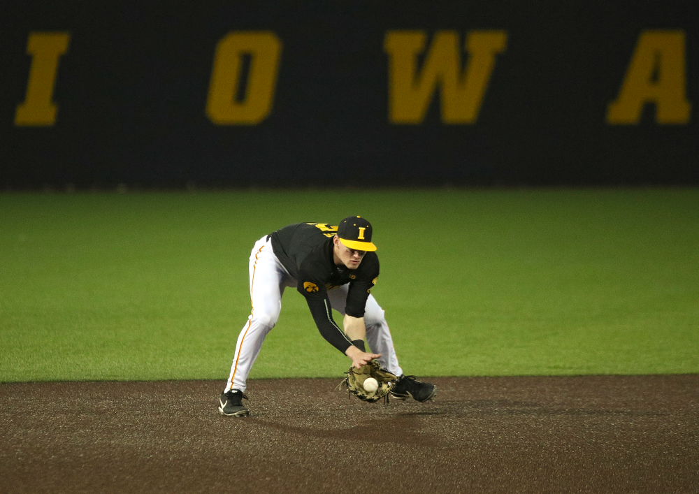 Iowa infielder Brendan Sher (2) fields a ground ball during the seventh inning of their game at Duane Banks Field in Iowa City on Tuesday, March 3, 2020. (Stephen Mally/hawkeyesports.com)