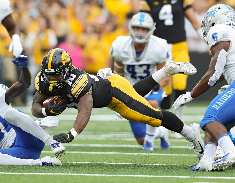 Iowa Hawkeyes running back Mekhi Sargent (10) dives forward for extra yards during the first quarter of their game at Kinnick Stadium in Iowa City on Saturday, Sep 28, 2019. (Stephen Mally/hawkeyesports.com)