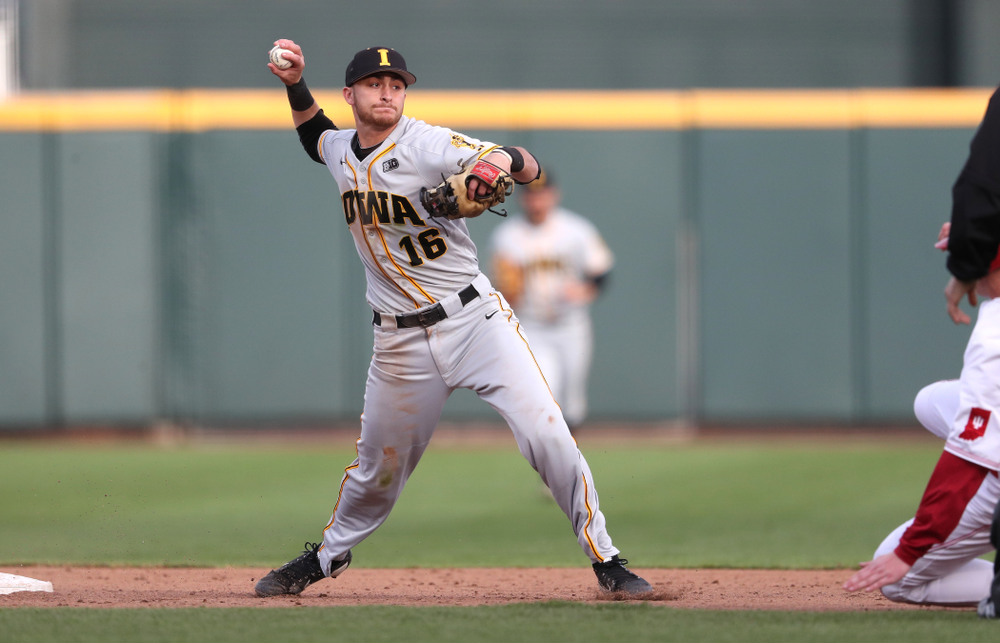 Iowa Hawkeyes Tanner Wetrich (16) turns a double play against the Indiana Hoosiers in the first round of the Big Ten Baseball Tournament Wednesday, May 22, 2019 at TD Ameritrade Park in Omaha, Neb. (Brian Ray/hawkeyesports.com)