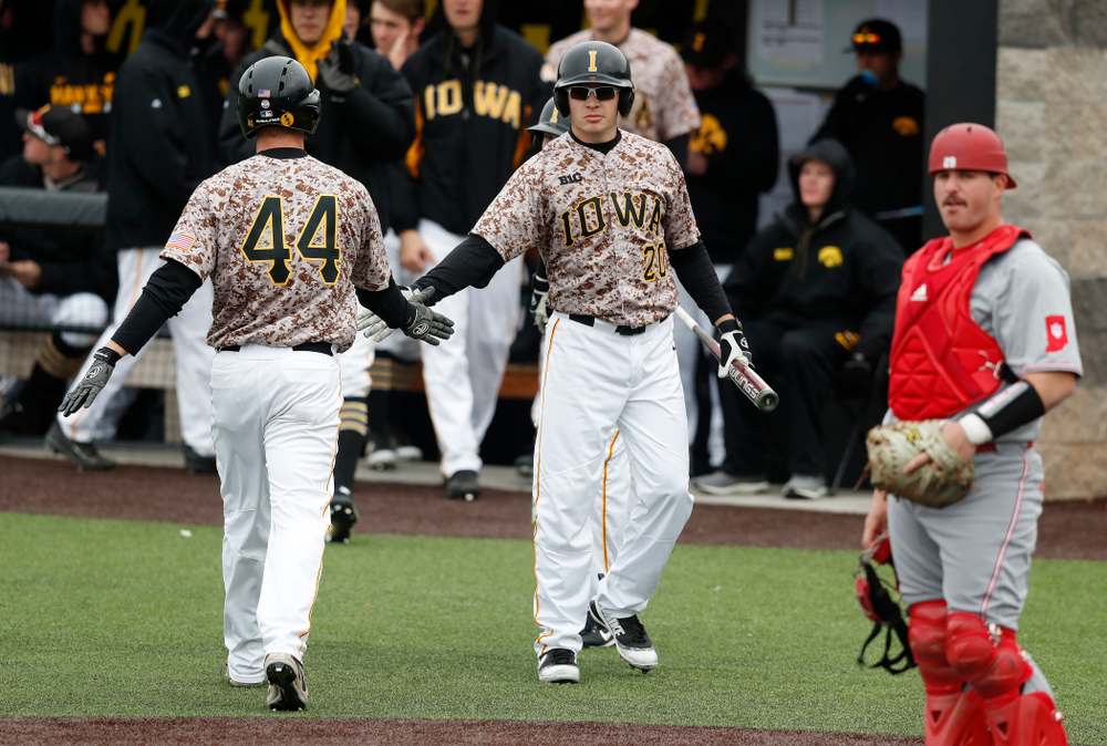 Iowa Hawkeyes outfielder Robert Neustrom (44) and catcher Austin Guzzo (20) during a double header against the Indiana Hoosiers Friday, March 23, 2018 at Duane Banks Field. (Brian Ray/hawkeyesports.com)