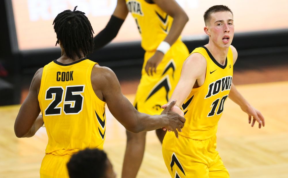 Iowa Hawkeyes guard Joe Wieskamp (10) high-fives Iowa Hawkeyes forward Tyler Cook (25) after making a shot against Wisconsin on November 30, 2018 at Carver-Hawkeye Arena. (Tork Mason/hawkeyesports.com)