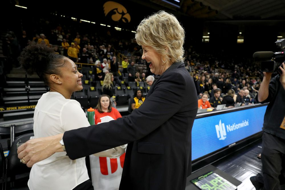 Former Hawkeye and Clemson graduate assistant Tania Davis hugs Iowa Hawkeyes head coach Lisa Bluder before their game Wednesday, December 4, 2019 at Carver-Hawkeye Arena. (Brian Ray/hawkeyesports.com)