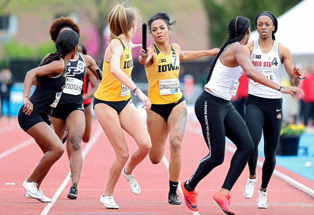 Iowa's Tria Simmons (right) hands off the baton to Payton Wensel during the women's 1600 meter relay event on the third day of the Big Ten Outdoor Track and Field Championships at Francis X. Cretzmeyer Track in Iowa City on Sunday, May. 12, 2019. (Stephen Mally/hawkeyesports.com)