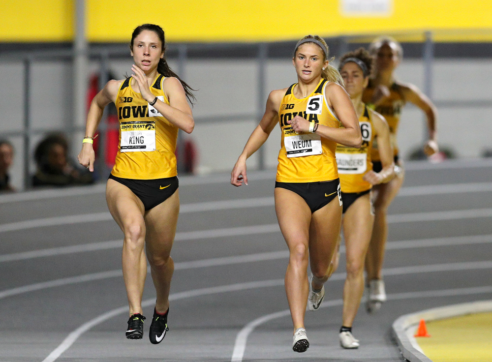 Iowa's Mallory King (from left) and Aly Weum run the women's 600 meter run event during the Jimmy Grant Invitational at the Recreation Building in Iowa City on Saturday, December 14, 2019. (Stephen Mally/hawkeyesports.com)