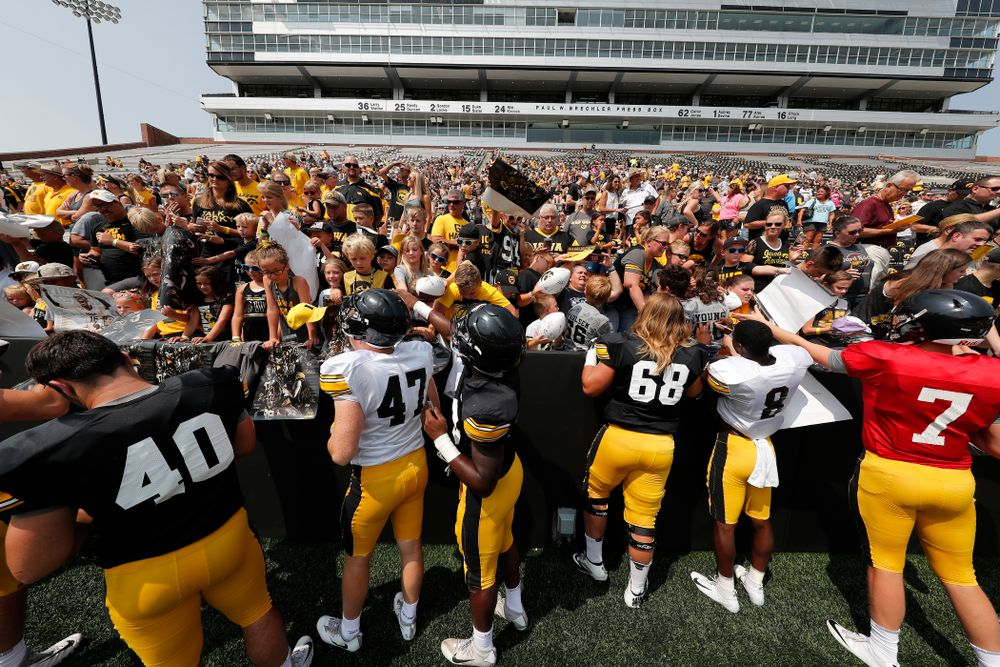 Members of the Hawkeye Football team sign autographs during Kids Day Saturday, August 11, 2018 at Kinnick Stadium. (Brian Ray/hawkeyesports.com)