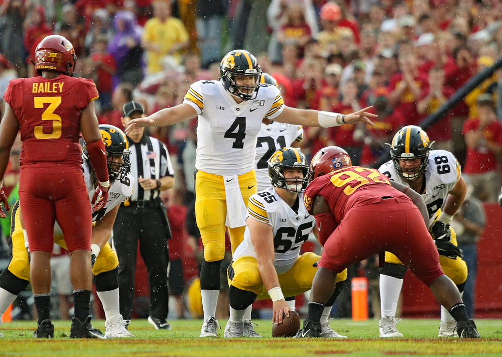 Iowa Hawkeyes quarterback Nate Stanley (4) motions as the line during the first quarter of their Iowa Corn Cy-Hawk Series game at Jack Trice Stadium in Ames on Saturday, Sep 14, 2019. (Stephen Mally/hawkeyesports.com)