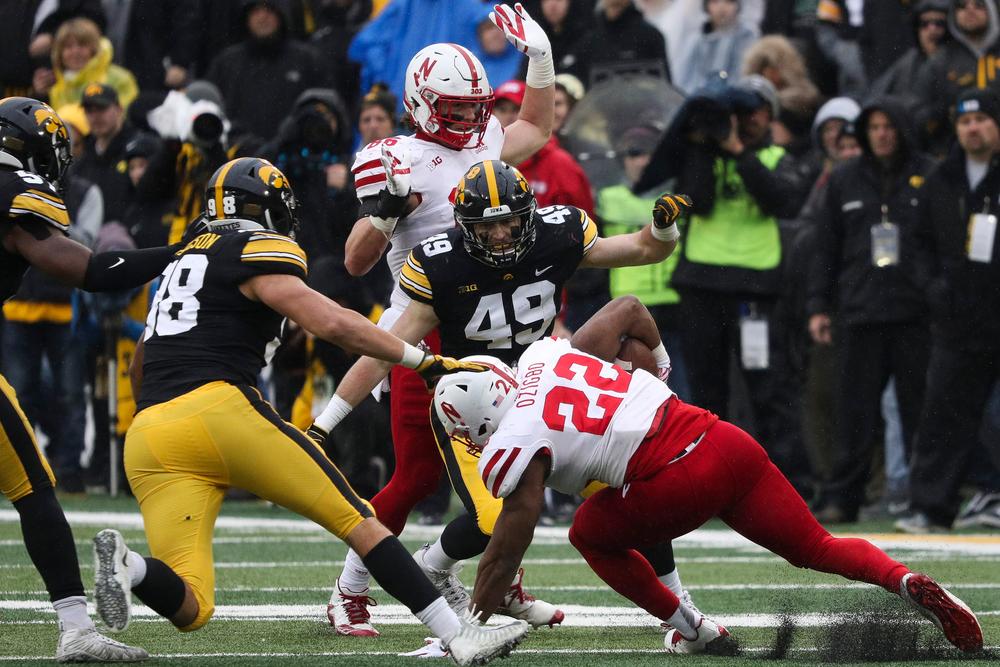 Iowa Hawkeyes linebacker Nick Niemann (49) makes a tackle during a game against Nebraska at Kinnick Stadium on November 23, 2018. (Tork Mason/hawkeyesports.com)