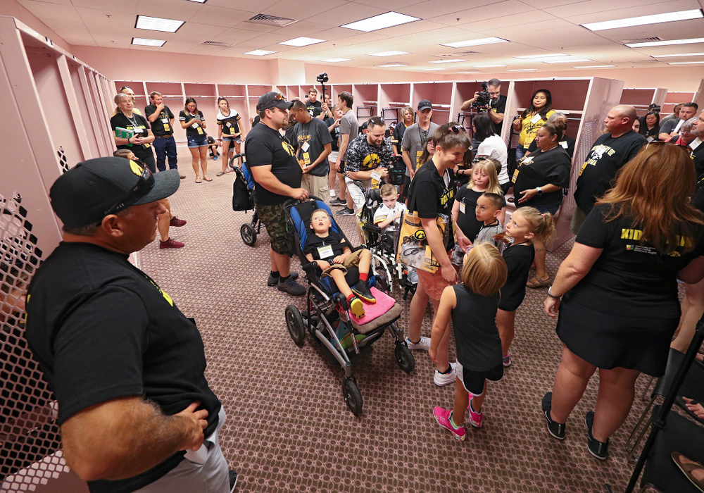 Kid Captains and their families tour the visitor's pink locker room during Kids Day at Kinnick Stadium in Iowa City on Saturday, Aug 10, 2019. (Stephen Mally/hawkeyesports.com)
