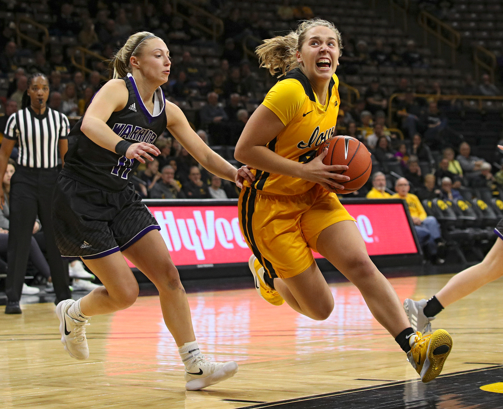 Iowa guard Kathleen Doyle (22) drives in with the ball during the third quarter of their game against Winona State at Carver-Hawkeye Arena in Iowa City on Sunday, Nov 3, 2019. (Stephen Mally/hawkeyesports.com)