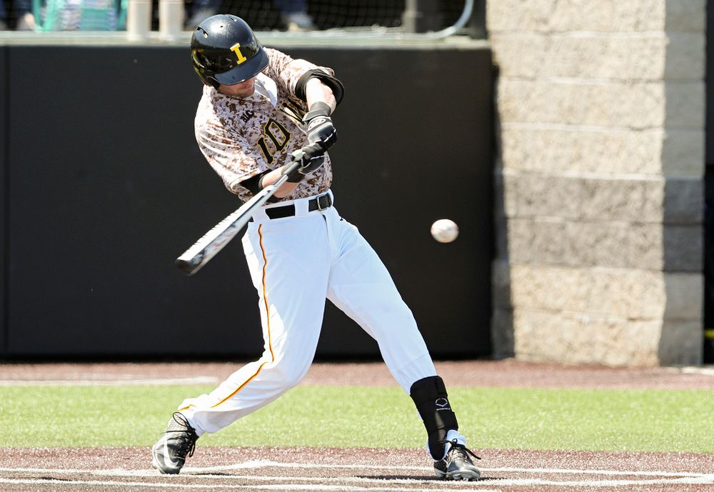Iowa Hawkeyes left fielder Chris Whelan (28) drives a pitch for a hit during the first inning of their game against UC Irvine at Duane Banks Field in Iowa City on Sunday, May. 5, 2019. (Stephen Mally/hawkeyesports.com)