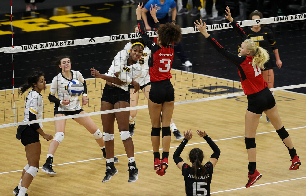 Iowa Hawkeyes middle blocker Amiya Jones (9) spikes the ball for match point during a match against Rutgers at Carver-Hawkeye Arena on November 2, 2018. (Tork Mason/hawkeyesports.com)