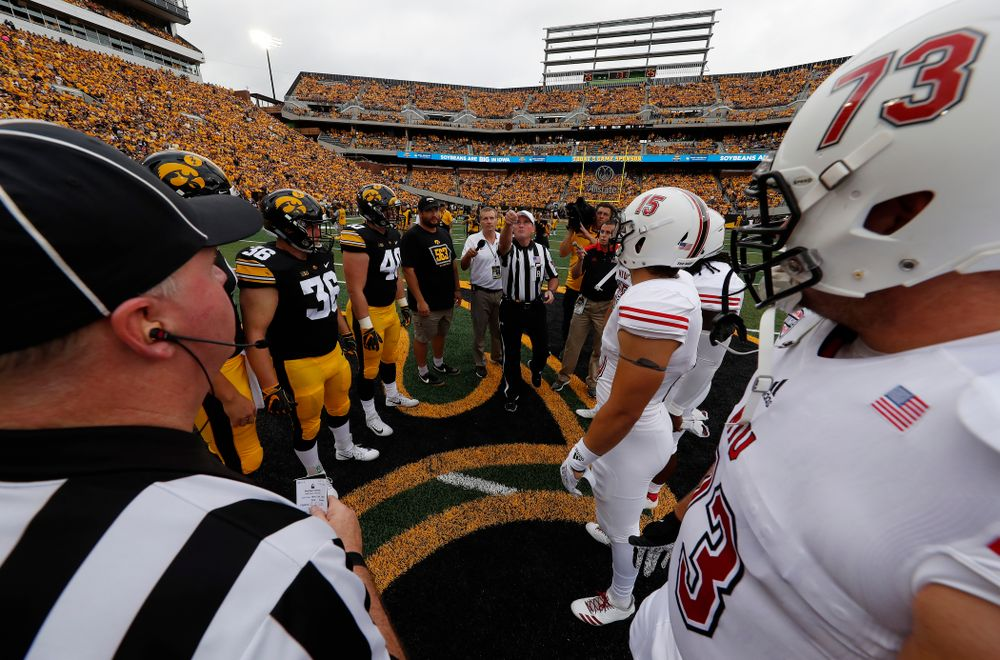 Captains Jake Gervase, Nate Stanley, Brady Ross, Parker Hesse, and Honorary Captain Julian Vandervelde against the Norther Illinois Huskies  Saturday, September 1, 2018 . (Brian Ray/hawkeyesports.com)