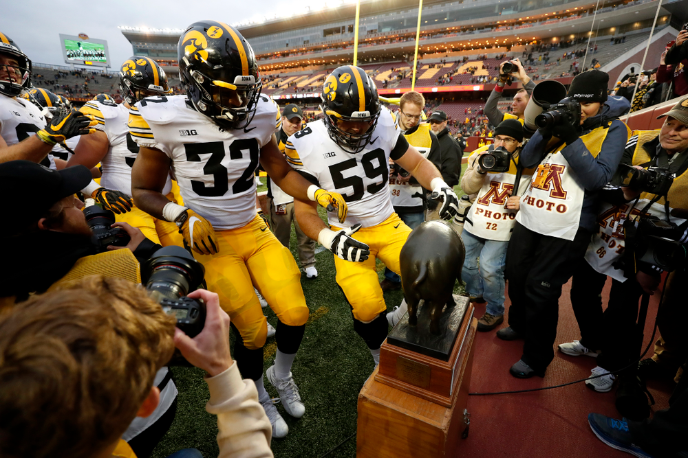 Iowa Hawkeyes linebacker Djimon Colbert (32) and offensive lineman Ross Reynolds (59) against the Minnesota Golden Gophers Saturday, October 6, 2018 at TCF Bank Stadium. (Brian Ray/hawkeyesports.com)