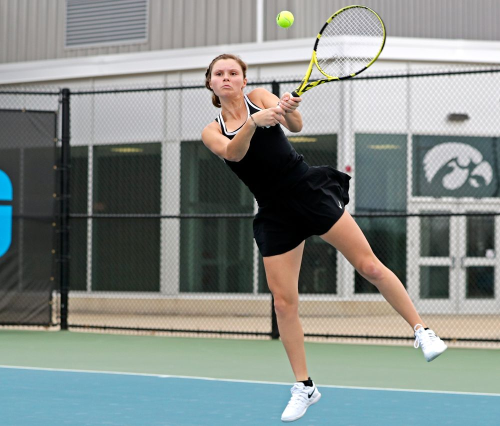 Iowa's Cloe Ruette returns a shot during their doubles match against Rutgers at the Hawkeye Tennis and Recreation Complex in Iowa City on Friday, Apr. 5, 2019. (Stephen Mally/hawkeyesports.com)