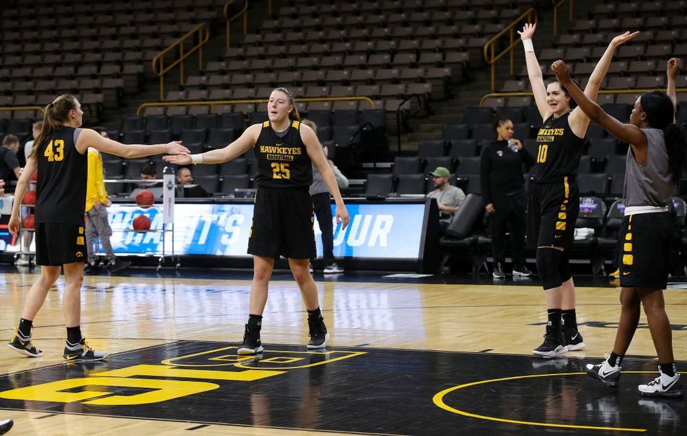 Iowa Hawkeyes forward Amanda Ollinger (43), center Monika Czinano (25), forward Megan Gustafson (10), and guard Tomi Taiwo (1) at a practice during the 2019 NCAA Women's Basketball Tournament at Carver Hawkeye Arena in Iowa City on Saturday, Mar. 23, 2019. (Stephen Mally for hawkeyesports.com)