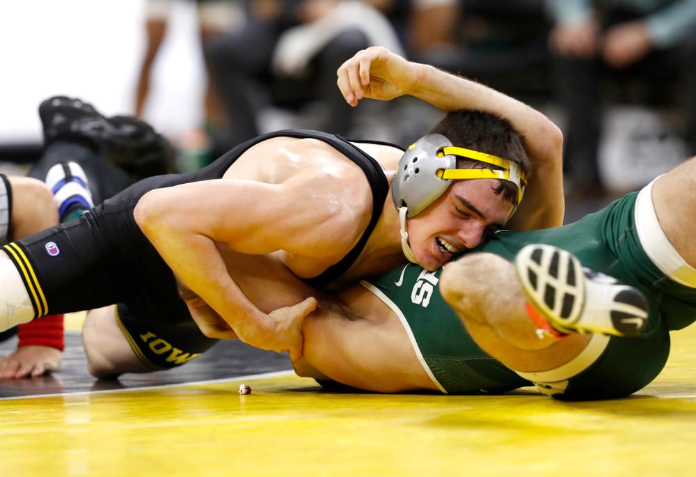 Iowa's Paul Glynn pins Michigan State's Matt Santos at 133 pounds.