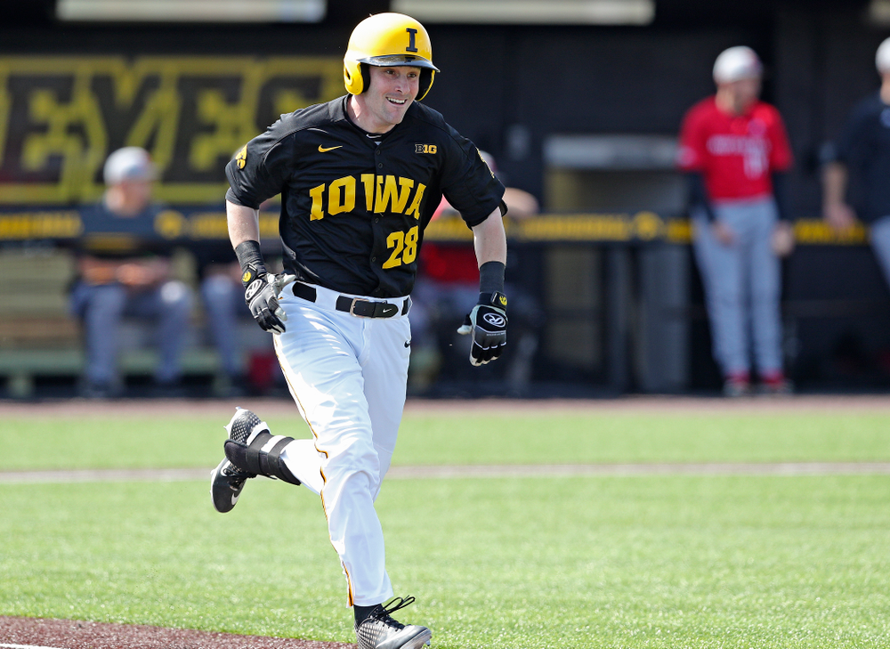 Iowa Hawkeyes left fielder Chris Whelan (28) runs to first on an infield single during the first inning of their game against Rutgers at Duane Banks Field in Iowa City on Saturday, Apr. 6, 2019. (Stephen Mally/hawkeyesports.com)
