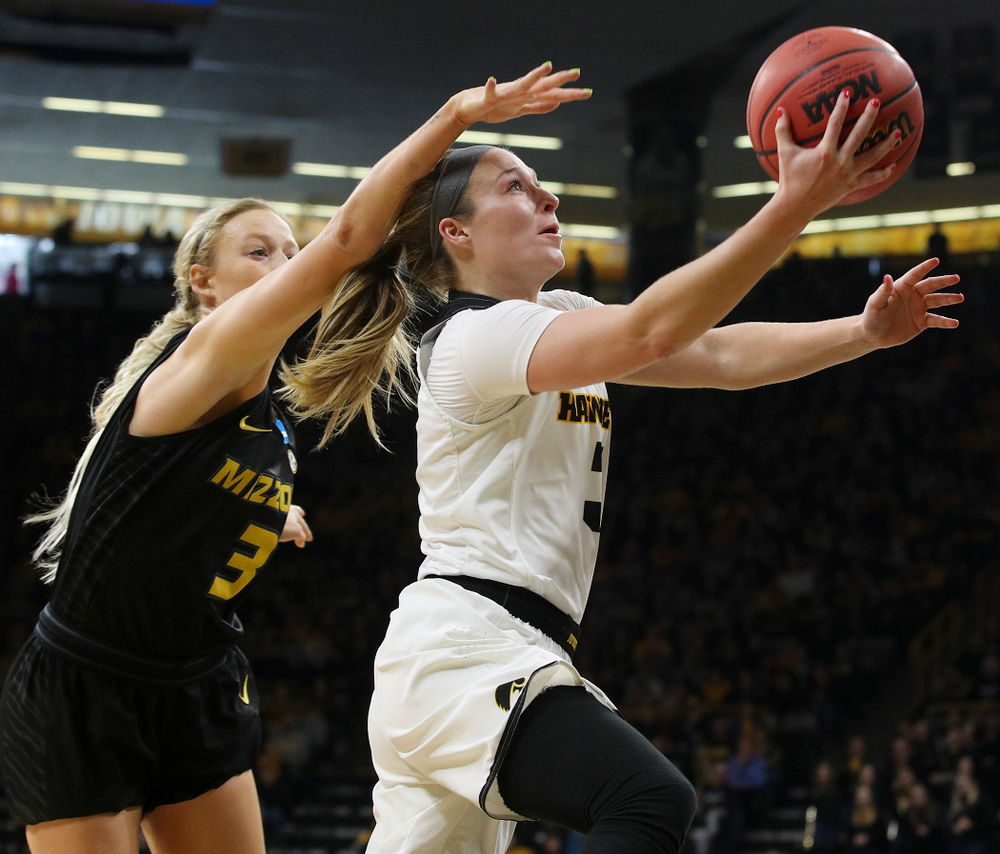 Iowa Hawkeyes guard Makenzie Meyer (3) scores a basket during the second quarter of their second round game in the 2019 NCAA Women's Basketball Tournament at Carver Hawkeye Arena in Iowa City on Sunday, Mar. 24, 2019. (Stephen Mally for hawkeyesports.com)