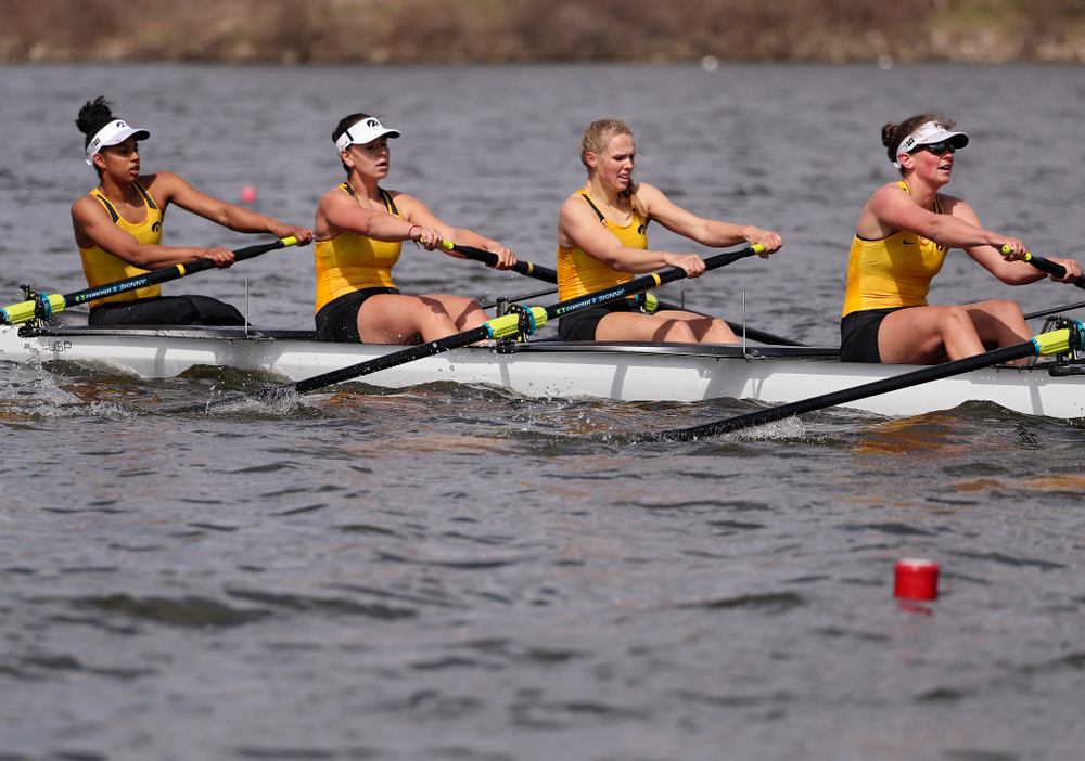 Iowa's Naomi Visser (from left), Elena Waiglein, Paige Schlapkohl, and Hannah Greenlee during their 1 Varsity 8 race against Wisconsin in their Big Ten Double Dual Rowing Regatta at Lake Macbride in Solon on Saturday, Apr. 13, 2019. (Stephen Mally/hawkeyesports.com)