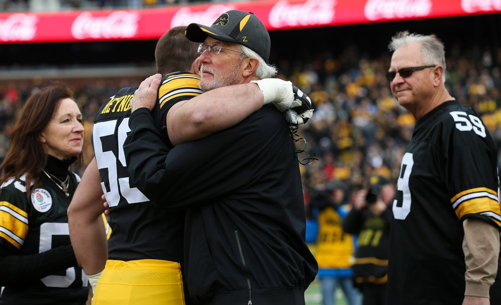 Iowa Hawkeyes offensive lineman Ross Reynolds (59) gets a hug from his father during Senior Day ceremonies before a game against Nebraska at Kinnick Stadium on November 23, 2018. (Tork Mason/hawkeyesports.com)