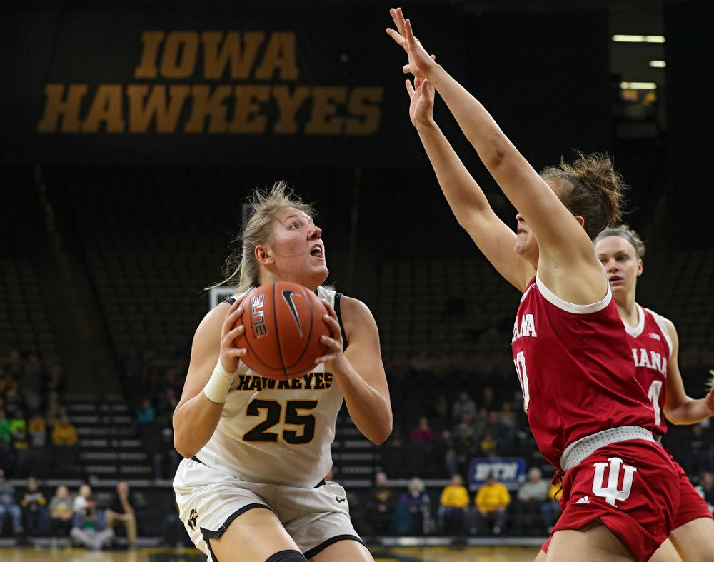 Iowa Hawkeyes forward Monika Czinano (25) eyes the basket during the first quarter of their game at Carver-Hawkeye Arena in Iowa City on Sunday, January 12, 2020. (Stephen Mally/hawkeyesports.com)