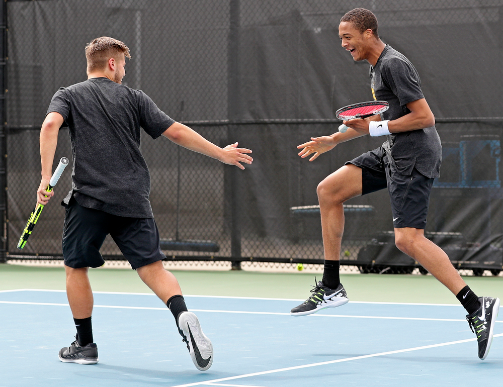 Iowa's Will Davies (from left) and Oliver Okonkwo celebrate a point during a double match against Ohio State at the Hawkeye Tennis and Recreation Complex in Iowa City on Sunday, Apr. 7, 2019. (Stephen Mally/hawkeyesports.com)