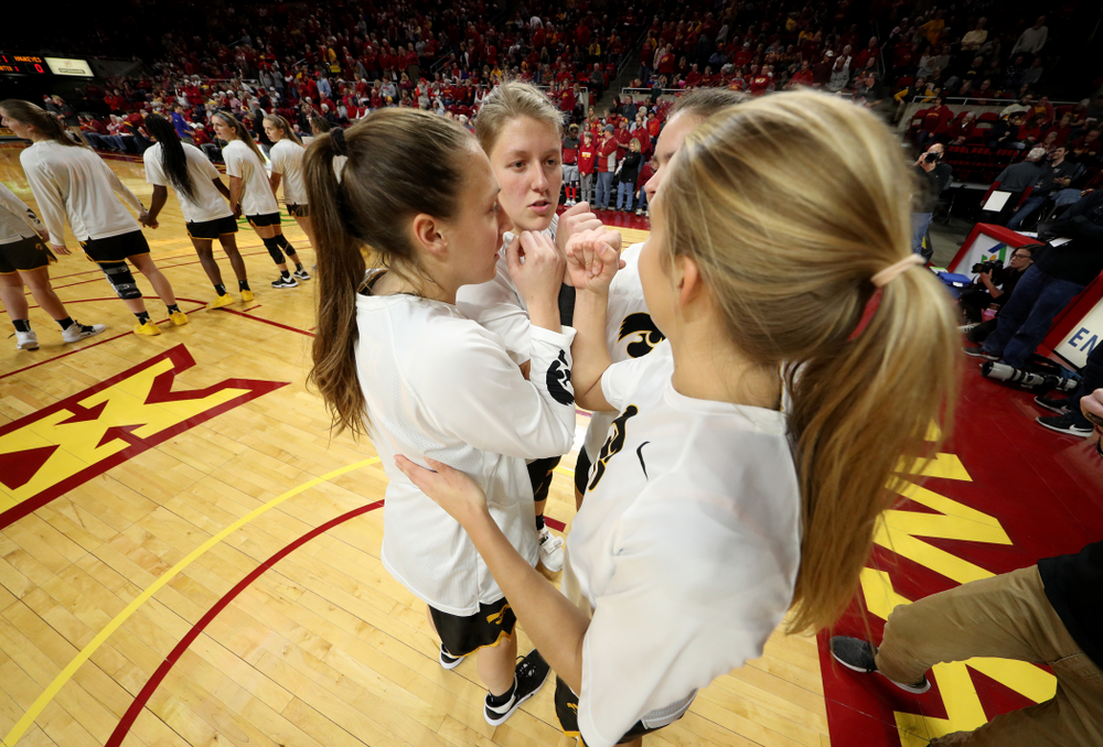 Iowa Hawkeyes forward/center Monika Czinano (25), forward Amanda Ollinger (43), Logan Cook (23), and forward/center Paula Vali?o Ramos (31) against the Iowa State Cyclones Wednesday, December 11, 2019 at Hilton Coliseum in Ames, Iowa(Brian Ray/hawkeyesports.com)