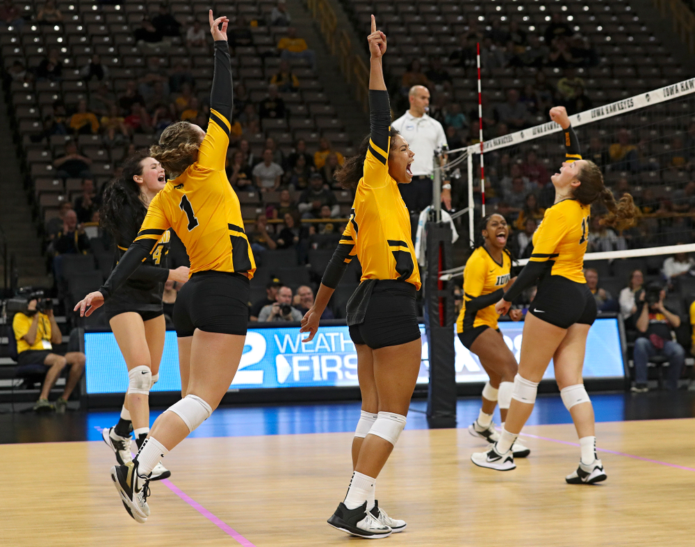 Iowa's Halle Johnston (4), Joslyn Boyer (1), Brie Orr (7), Griere Hughes (10), and Blythe Rients (11) celebrate a score during their match at Carver-Hawkeye Arena in Iowa City on Sunday, Oct 20, 2019. (Stephen Mally/hawkeyesports.com)