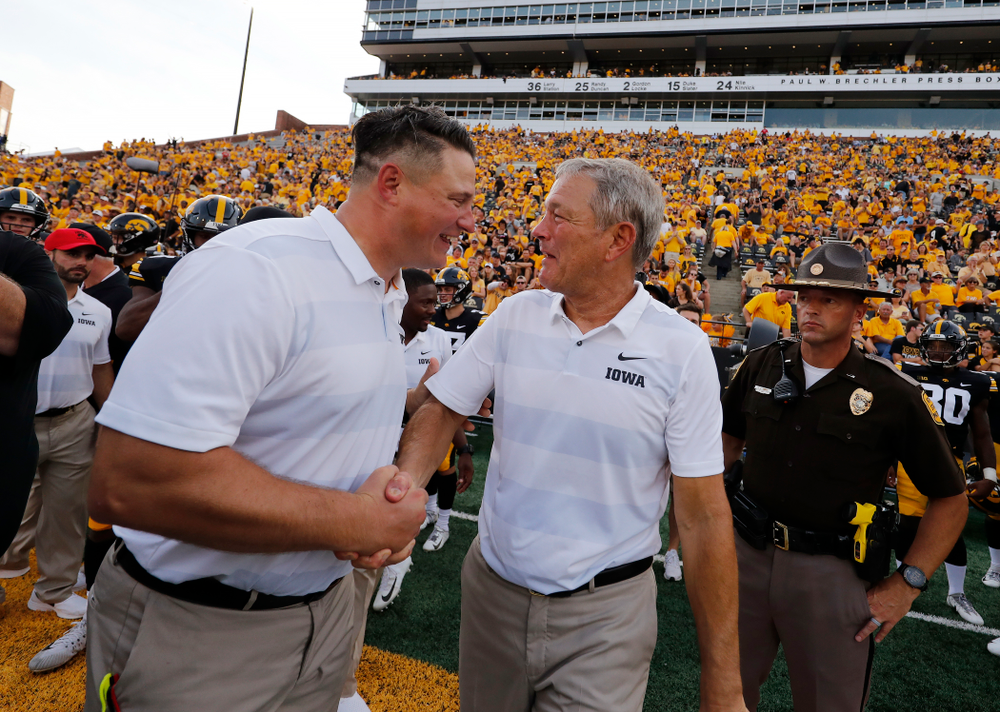 Iowa Hawkeyes head coach Kirk Ferentz shakes hands with his son offensive coordinator Brian Ferentz following their game against the Northern Illinois Huskies Saturday, September 1, 2018 at Kinnick Stadium. (Brian Ray/hawkeyesports.com)