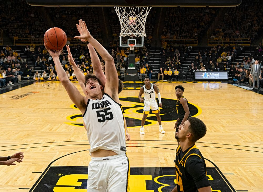 Iowa Hawkeyes center Luka Garza (55) scores a bucket during the second half of their their game at Carver-Hawkeye Arena in Iowa City on Sunday, December 29, 2019. (Stephen Mally/hawkeyesports.com)