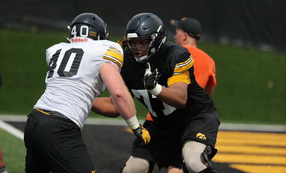 Iowa Hawkeyes offensive lineman Alaric Jackson (77) against defensive end Parker Hesse (40) during the third practice of fall camp Sunday, August 5, 2018 at the Kenyon Football Practice Facility. (Brian Ray/hawkeyesports.com)