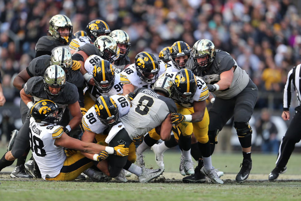 Iowa Hawkeyes linebacker Djimon Colbert (32), linebacker Jack Hockaday (48), and defensive end Sam Brincks (90) against the Purdue Boilermakers Saturday, November 3, 2018 Ross Ade Stadium in West Lafayette, Ind. (Brian Ray/hawkeyesports.com)