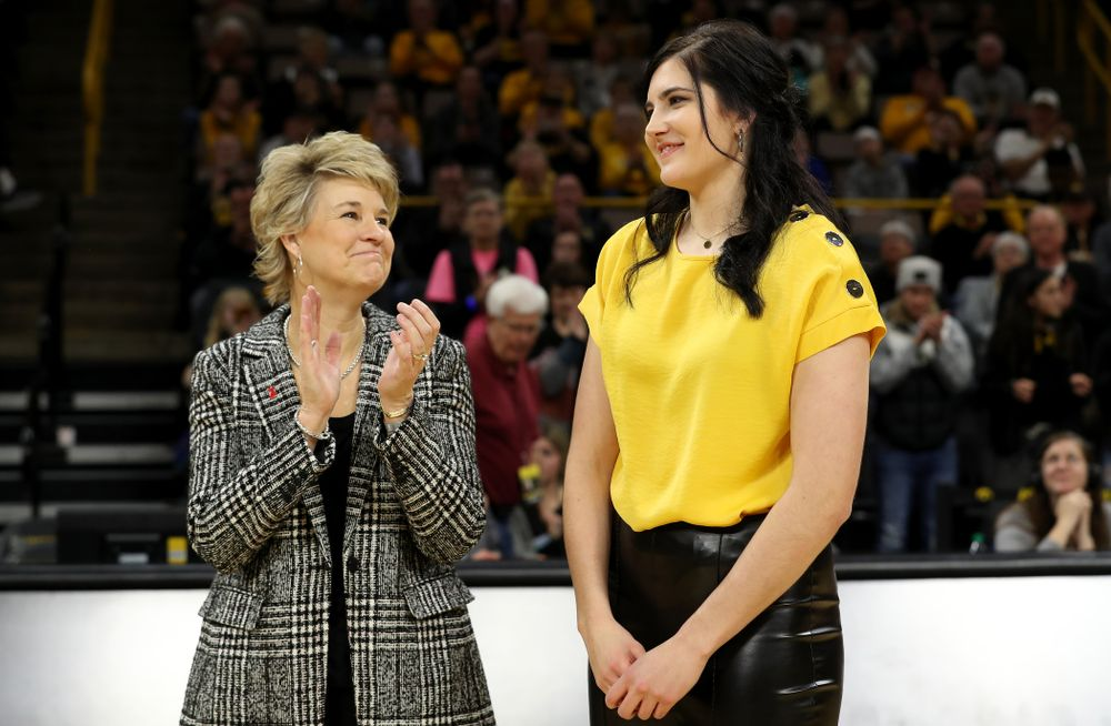 Megan Gustafson stands with Iowa Hawkeyes head coach Lisa Bluder during a jersey retirement ceremony Sunday, January 26, 2020 at Carver-Hawkeye Arena. (Brian Ray/hawkeyesports.com)